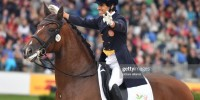 Goncalo Carvalho of Portugal gestures on his horse Batuta in the ...